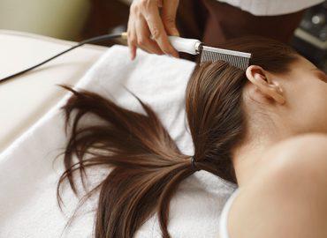 Brushing Beautiful Woman Long Hair. Hair Beauty Treatment